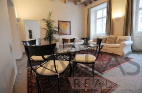 Rent of a charming fully furnished 2-bedroom apartment with original wooden painted ceiling